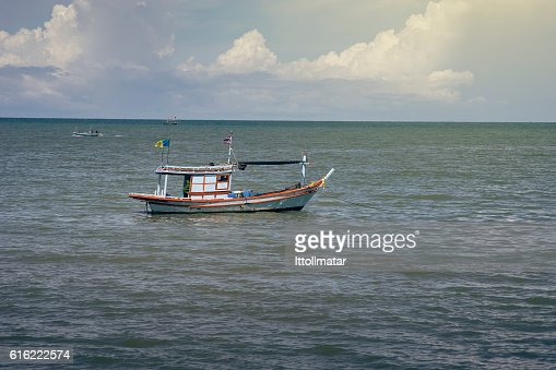 traditional fishing boat laying on the sea : Photo