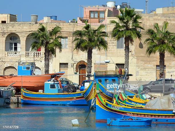 CONTENT] Traditional fishing boats in the harbour of Marsaxlokk malta