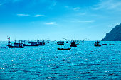 Traditional fishing boats on Gulf Of Thailand sea in island of Pattaya, Thailand