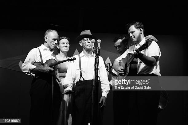 Traditional folk and oldtimey musicians including fiddler Fred Price folk singer Jean Ritchie banjoist musician and singer Clarence Ashley guitarist...