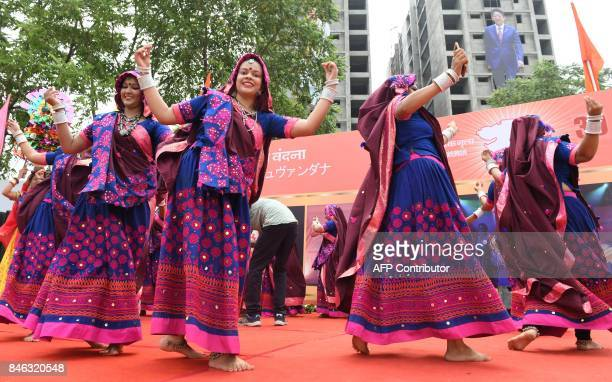 Traditional folk dancers from the Indian state of Gujarat rehearse a 'Garba' dance as they prepare to welcome Japanese Prime Minister Shinzo Abe and...