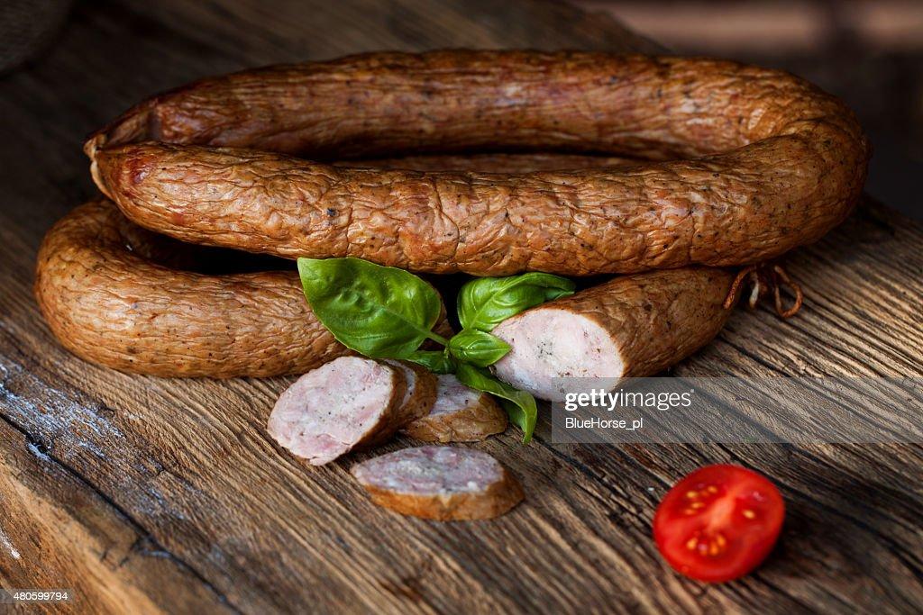 Traditional food. Smoked sausage. : Stock Photo