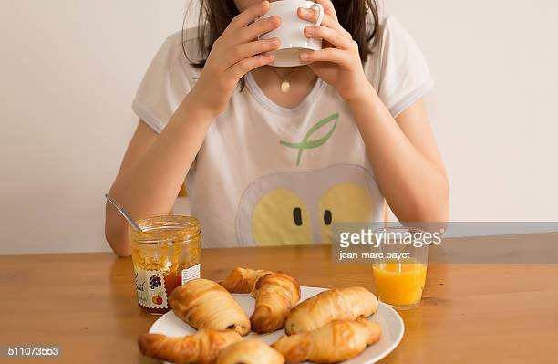 Traditional french breakfast with croissant pain au chocolat orange juice and coffre