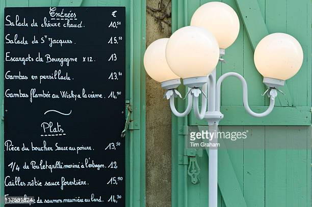 Traditional French Cafe menu of Entrees and Plats in quaint town of Castelmoron d'Albret in Bordeaux region Gironde France