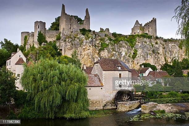 Traditional French houses and Chateau Guichard ruins at Angles Sur L'Anglin medieval village Vienne near Poitiers France