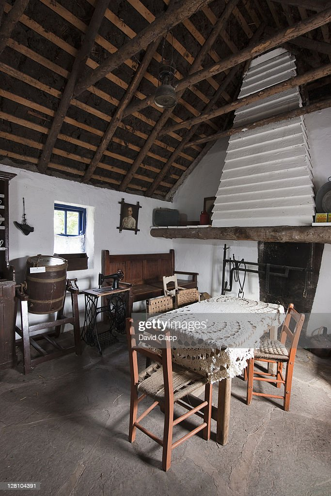 Traditional furnishings inside a croft at The Kerry Bog Village, a traditional Irish peat cutters village situated near Killorglin, on the Ring of Kerry, County Kerry, Republic of Ireland : Stock Photo