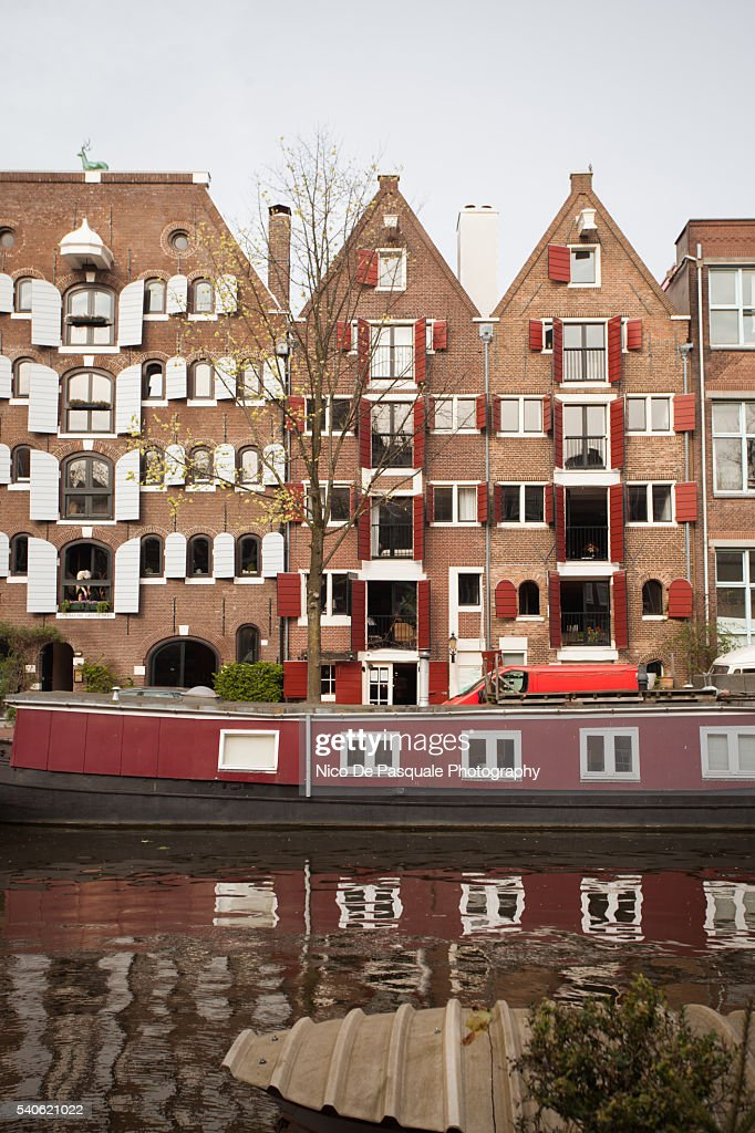 Traditional Gabled houses reflected in canal