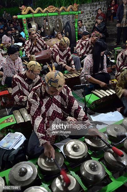 Traditional gamelan music accompanies 'Sweet Friday' pilgrimage at Maria Lourdes cave Puh Sarang Church Sweet Friday Pilgrimage or 'Jumat Legi' is a...