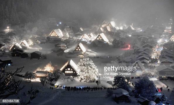 Traditional 'gasshozukuri' thatched farm houses are snowcovered and illuminated on January 22 2017 in Shirakawa Gifu Japan The popular sightseeing...