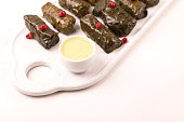 Traditional georgian cuisine. Dolma in grape leaves with pomegranate and parsley