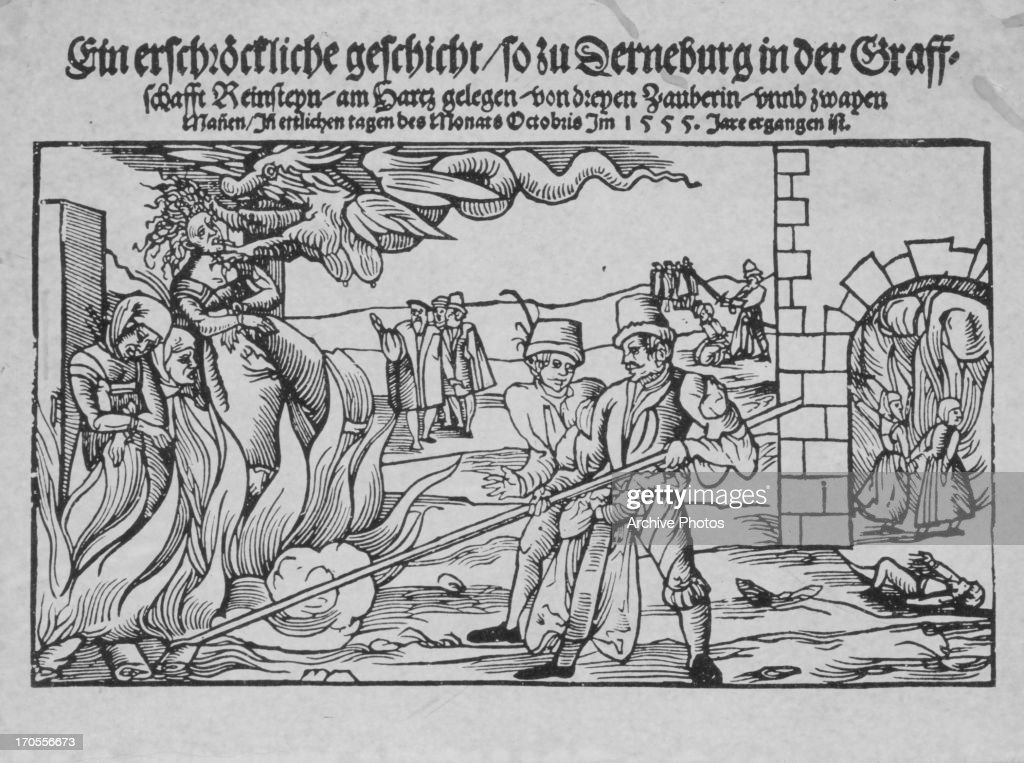 Traditional German woodcut engraving showing the persecution of witches by burning at the stake