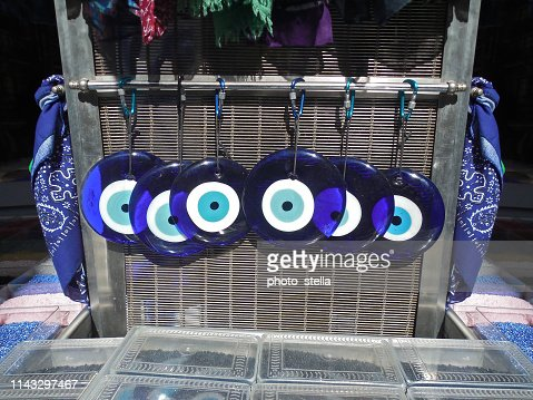 traditional greek blue evil eyes from glass at a souvenir shop - symbol of protection - decorative elements : Stock Photo