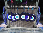traditional greek blue evil eyes from glass at a souvenir shop - symbol of protection
