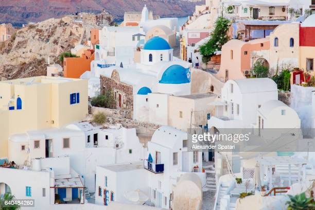 Traditional Greek white houses in Oia village, Santorini, Cyclades, Greece