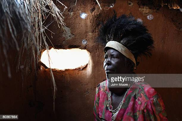 Traditional healer Emily Mpofu stands in her clinic March 22 2008 in the small village of Nhlekiyana in central Zimbabwe She consults the spirits to...