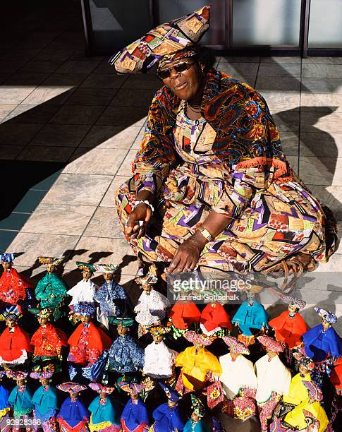 Traditional Herero woman in selling puppets at Windhoek , Namibia