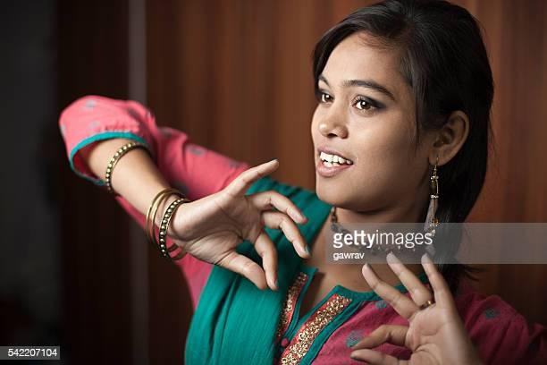 Traditional Hindu teenage girl dancing at home.