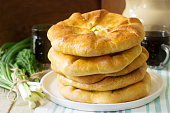 Traditional homemade Romanian and Moldovan pies - Placinta, served with wine. Rustic style, selective focus.