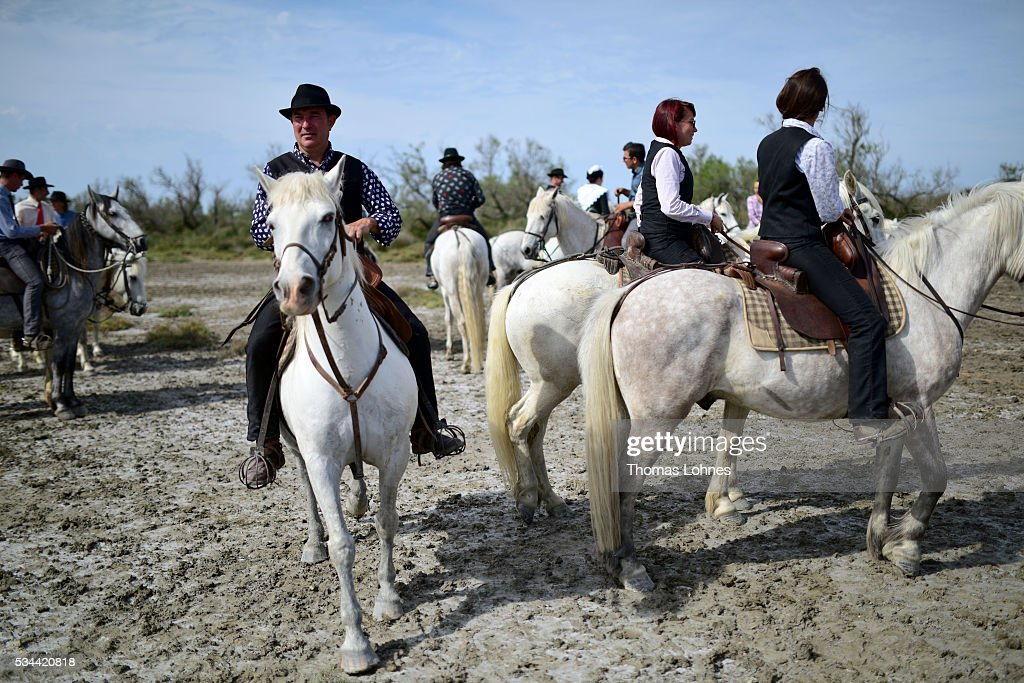 'Gardians', traditional horsemen, pictured on May 26, 2016 in Saintes-Maries-de-la-Mer near Arles, France. The 'Guardians' celebrate the day in memory of the Marquis de Baroncelli and catch young bulls and brand them. Marie Segretier help them to wrangel the bulls and brand them. She is the only 'cow girl' in the area of Staintes-Maries-de-la-Mer (Camargue). She started with 5-6 years.