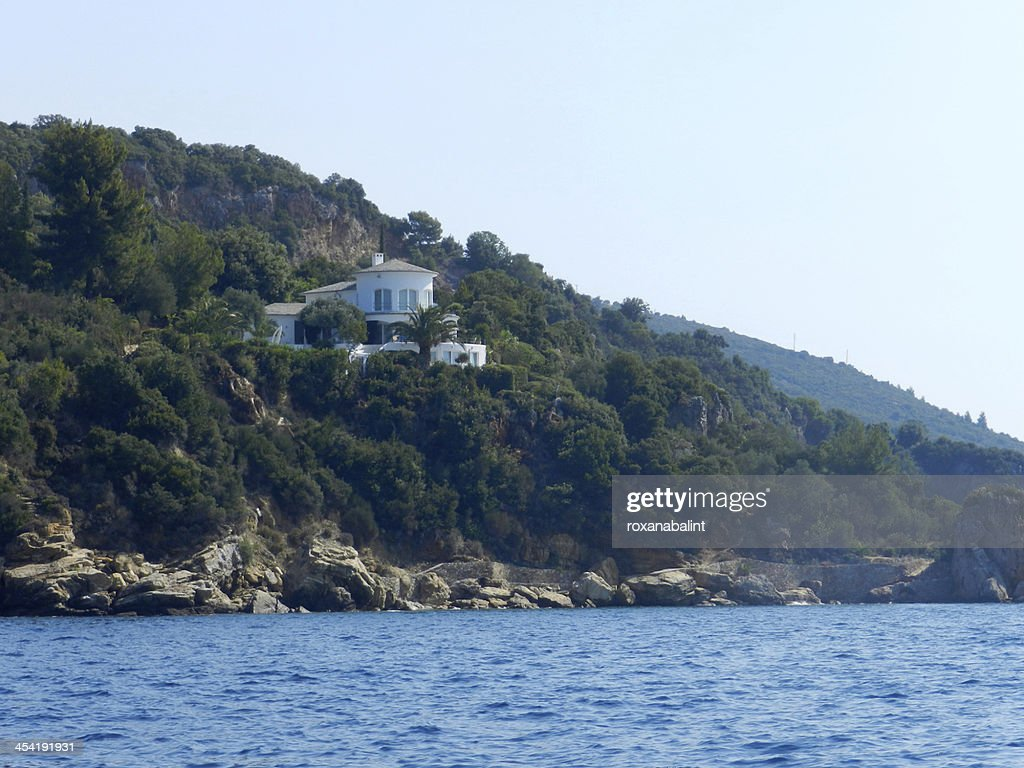 Traditional hous at coast of Skiathos island : Stock Photo