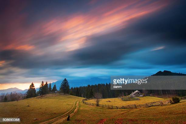 Traditional house in mountain with clouds moving
