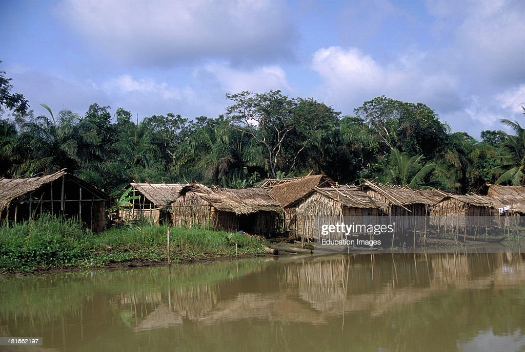 Traditional houses on the Nun River in Bayelsa State, Nigeria. The Niger Delta, West Africa.