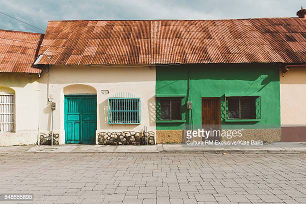 Traditional houses with corrugated roofs, Flores, Guatemala, Central America