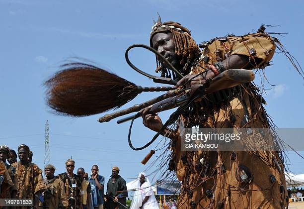 Traditional hunters called Dozo wait for Ivorian President Alassane Ouattara to arrive to the official launch of the construction works of a 30 km...