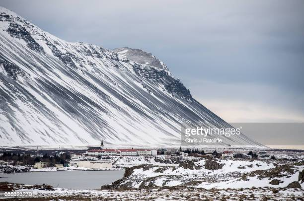 A traditional Icelandic church is seen amongst the town of Borgarnes at the foot of mountains on March 27 2017 at Borgarnes Iceland Iceland's economy...