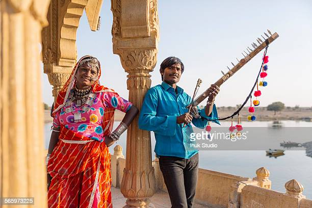 Traditional Indian couple standing in monument, Jaisalmer, Rajasthan, India
