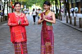 Two women in traditional Indonesian clothes.