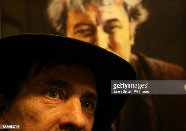 Traditional Irish music fan Gerard Dowling pictured in front of a portrait of Seamus Heaney watches Taoiseach Bertie Ahern launch the Temple Bar...