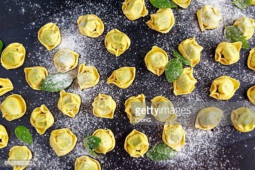 Traditional Italian homemade spinach and ricotta tortellini : Stock Photo