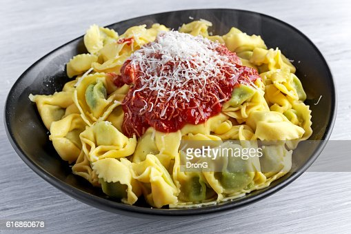 Traditional Italian homemade spinach and ricotta tortellini With marinara souce : Stock Photo