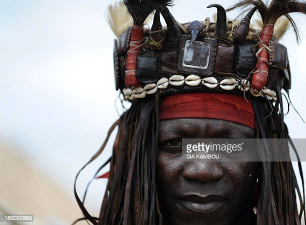 A traditional Ivorian Dozo hunter poses for the photographer on September 27 2013 in Kani in the Seguela department 592km from Abidjan after a...