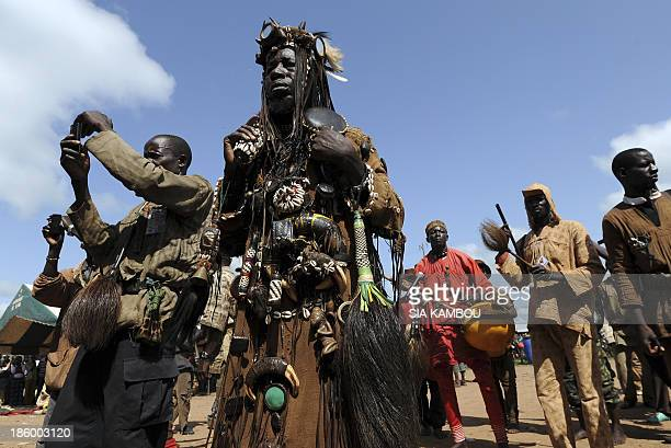 Traditional Ivorian Dozo hunters members of the Binkadi association that gathers all Dozos in the region gather on September 27 2013 in Kani in the...