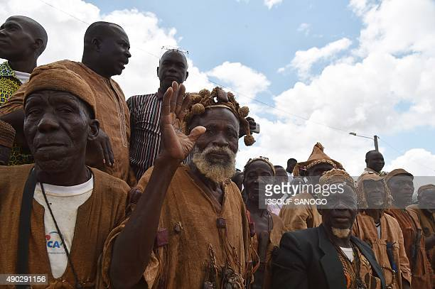 Traditional Ivorian Dozo hunters wait for arrival of Ivory Coast President Alassane Ouattara in a street of Daloa on September 27 during Ouattara's...