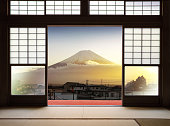 Traditional Japanese indoor  house and paper sliding doors and tatami mat open to View of a beautiful Fuji mountain in sunset and japanese house in autumn season. Kawaguchiko, Yamanashi, Japan