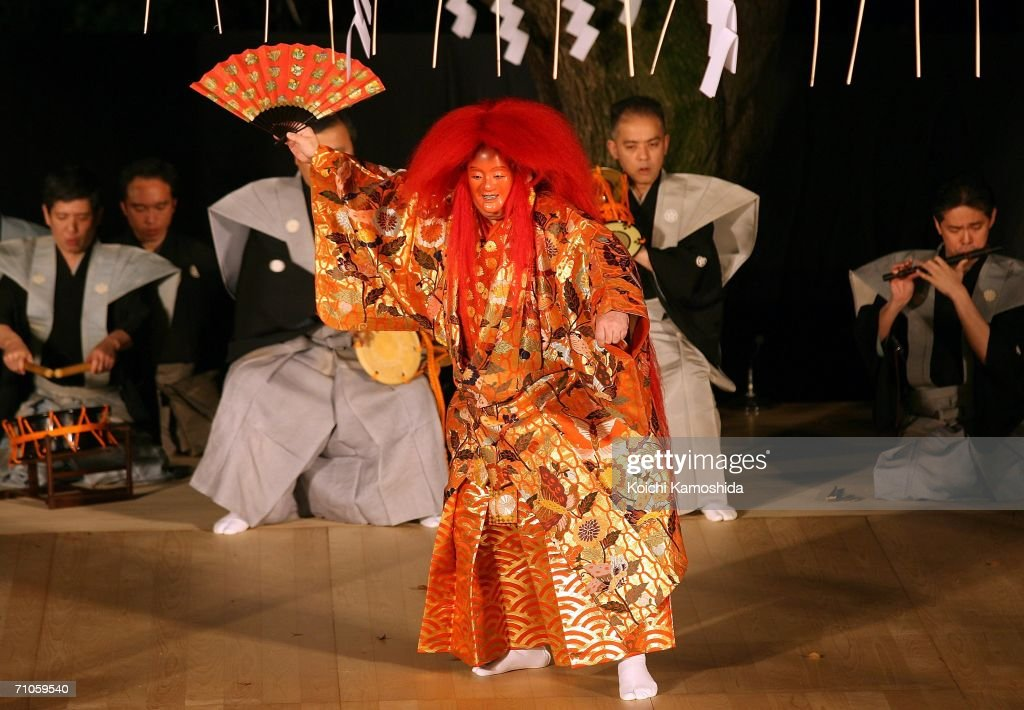 Traditional Japanese Noh actors give a performance during the annual Omiya Takigi Noh Performance at Hikawa Shrine on May 26, 2006 in Saitama, Japan. Takigi Noh is performed outside with torchlights. It originated in the practice of burning sacred firewood.