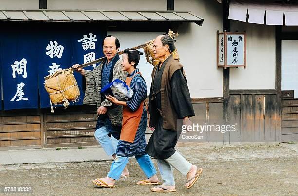 Traditional Japanese village and peasants walking