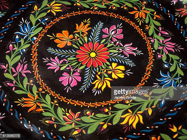 Traditional lacquered plate from Michoacan, Mexico