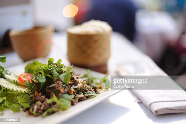 Traditional lao food - larb and basket of sticky r