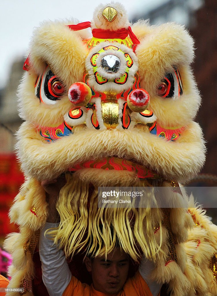 Traditional Lion Dancers lead the New Year parade on February 10, 2013 in London, England. London's Chinese community celebrate the start of the Year of The Snake with traditional dancing, music and fireworks.