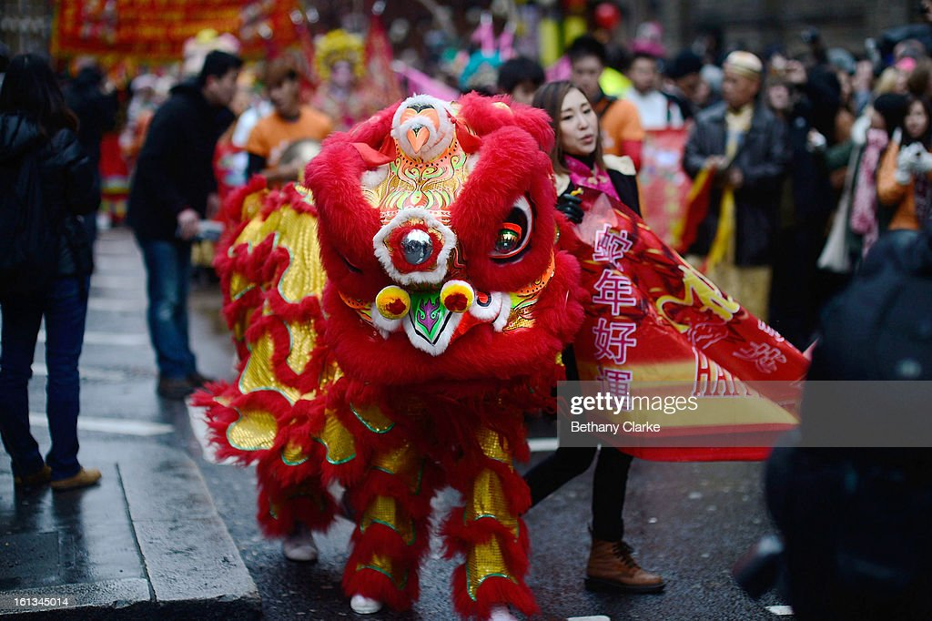 Traditional Lion Dancers lead the New Year paraded on February 10, 2013 in London, England. London's Chinese community celebrate the start of the Year of The Snake with traditional dancing, music and fireworks.