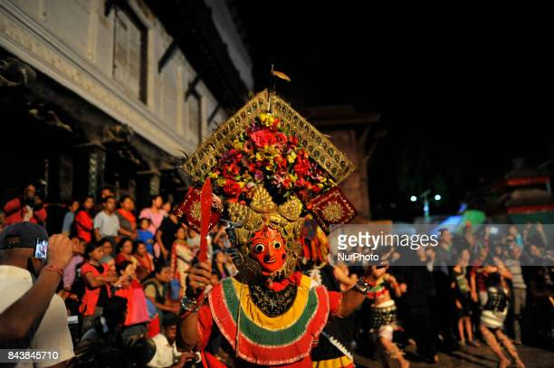 A traditional Mahankali mask dancer dancing in the ritual tunes on the fifth day of Indra Jatra Festival celebrated at Basantapur Durbar Square...