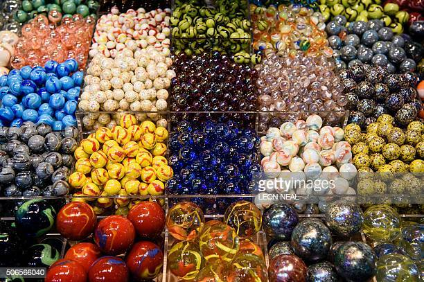 Traditional marbles are displayed on a trade stand at the Toy Fair 2016 in west London England on January 24 2016 The annual fair is the largest of...