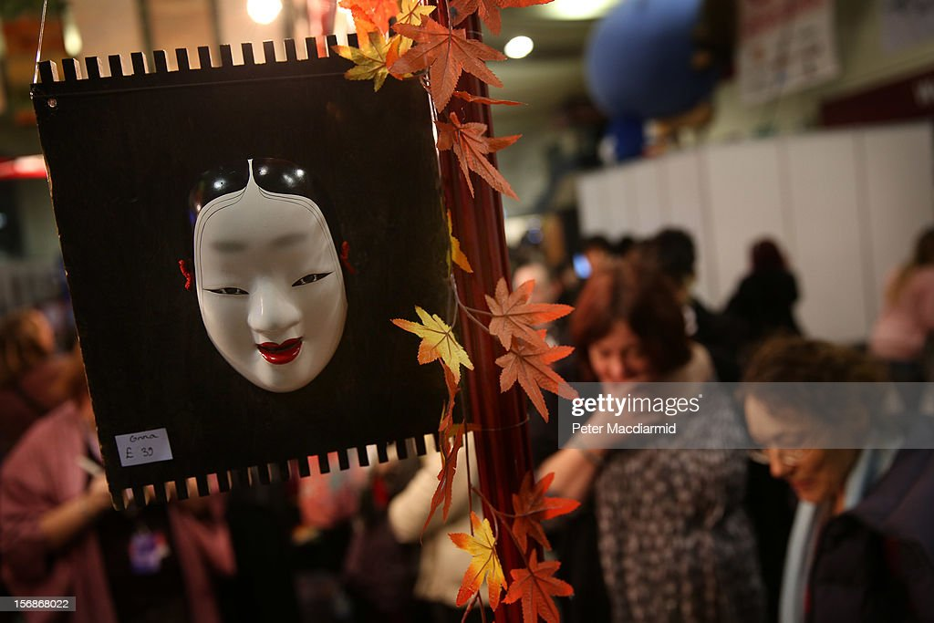 A traditional mask is displayed for sale at The Hyper Japan event at Earls Court on November 23, 2012 in London, England. The show is the UK's biggest Japanese Culture event, with stalls selling clothing and artwork. live music, Japanese food and computer gaming areas are also on show. Many attendees dress up as anime characters or in the lolita fashion widespread in Japan.