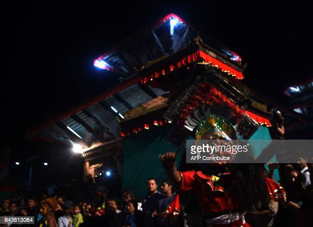 Traditional masked dancers perform on the fifth day of the Indra Jatra festival on September 7 2017 in Kathmandu Nepal's weeklong festival celebrates...