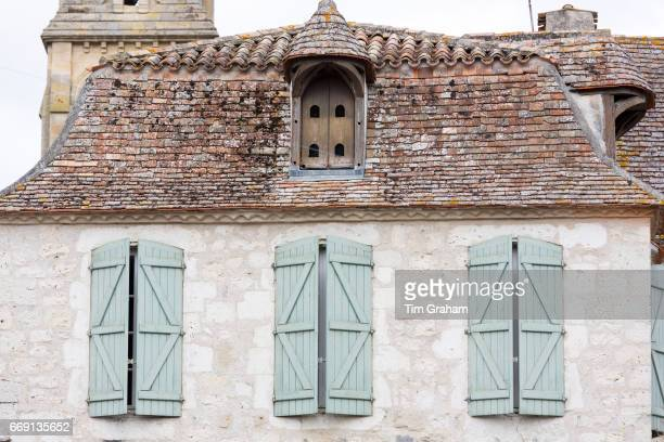 Traditional medieval old stone architecture and shutters in 13th Century bastide fortified town of Eymet on September 19 2015 in Aquitaine France