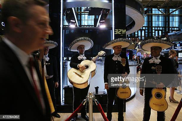 A traditional Mexican band plays on the floor of the New York Stock Exchange to celebrate Cinco de Mayo on May 5 2015 in New York City Stocks tumbled...